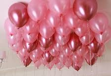 15 Gas filled pink Balloons tied to ribbons