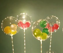 4 Transparent bobo balloons stuffed with coloured balloons with lights