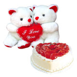 2 teddies 6 inch each and 1 kg heart shape strawberry cake