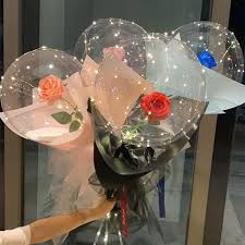 Four Transparent bobo balloons with roses inside and LED Light for anniversary