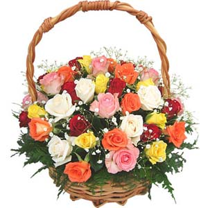 12 Mixed color flowers arrangement in a basket