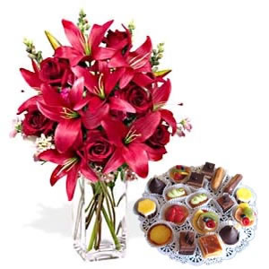 12 assorted pastries and 6 lilies in a vase