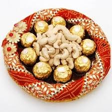 250 gms cashews and 16 ferrero in a tray