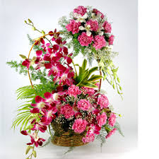 10 orchids with carnations in basket and carnations on handle arrangement