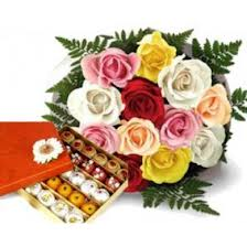 500 gm Kaju Roll and bouquet of 10 Mixed color roses with a card