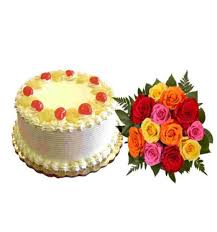 1/2 kg eggless Pineapple Cake with 4 pink roses