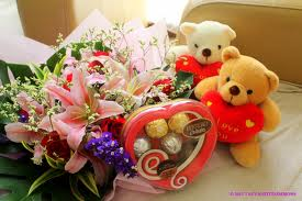 flowers and chocolates with two teddies