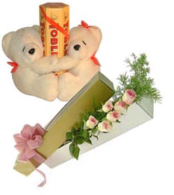 2 teddies with 6 roses and tobler chocolates.