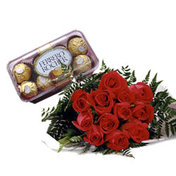 Red roses and 16 pieces ferrero rocher.