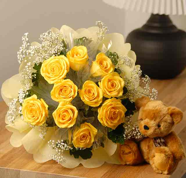 20 yellow roses in a basket with a teddy.