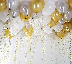 15 Gas filled gold and silver Balloons tied to ribbons
