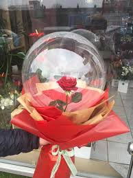 1 transparent balloon 1 red rose arrangement with red wrapping