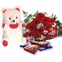 cute teddy bear with 6 red roses