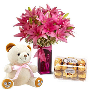 6 lilies vase with 16 ferrero chocolates and 6 inch teddy