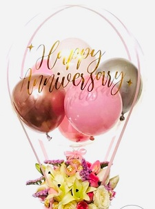 Happy anniversary transparent printed transparent balloon with 4 pink and red balloons and lilies roses arrangement
