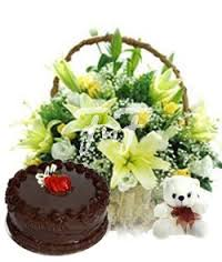 Basket of 8 lilies, teddy bear and 1/2 kg cake