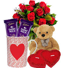 12 red roses, coffee mug 2 chocolates, teddy bear and 2 hearts
