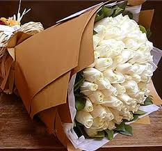 50 white roses with brown wrapping