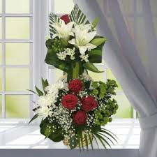 2 Feet tall arrangement of 6 Red Roses 6 White Lilies 6 white crysanthemums or gerberas and curled  draceana leaves