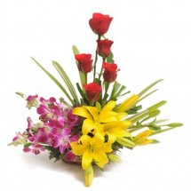 Basket of 5 red roses 3 Purple Orchids and 2 Yellow Lily