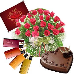 24 red roses basket with 4 temptation chocolates and 1 kg Cake and complimentary card