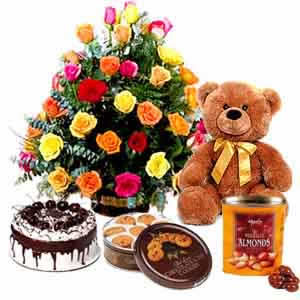 Basket 24 mix roses, 1/2 kg cake, teddy, cookies and chocolates