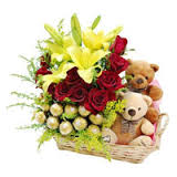 Basket of 4 lilies 12 red roses 16 ferrero chocolates and 2 teddy bears
