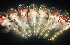 8 Red rose inside 8 transparent Luminous balloon with Red and white Wrapping